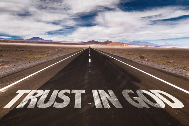 Trust in God written on desert road